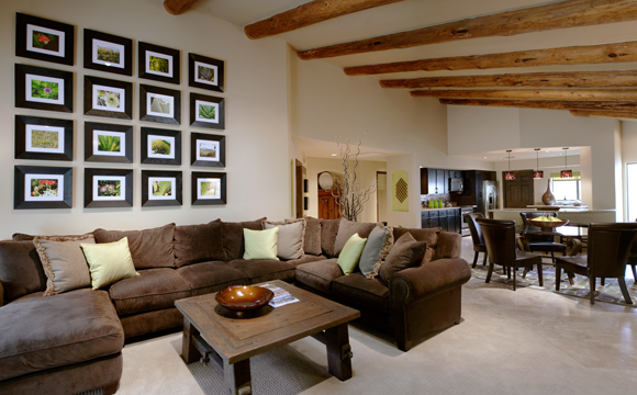 Large loung area with elegant furnishings and large wooden beams