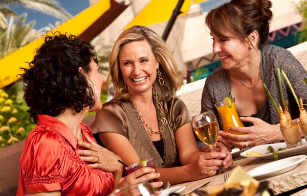 Women enjoying drinks and food outside