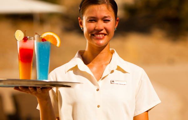 Waitress carrying two cocktails