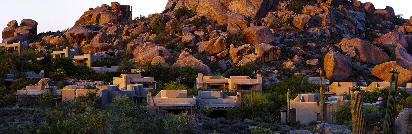 Executive Suites - view of accommodations surrounded by large boulder formations at sunset