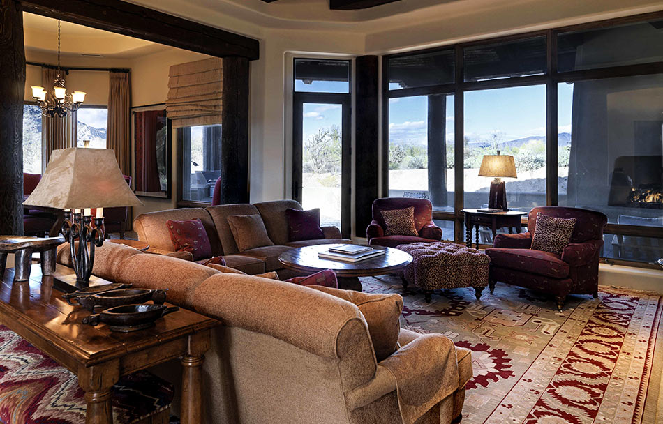Spacious lounge with comfy chairs and views of the Sonoran Desert